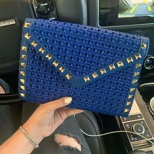 Blue braided clutch with studs